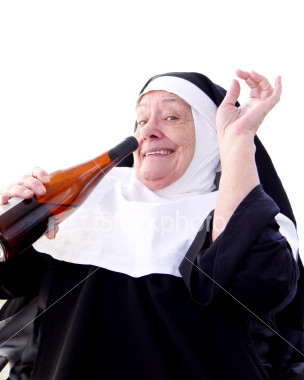 nun drinking wine